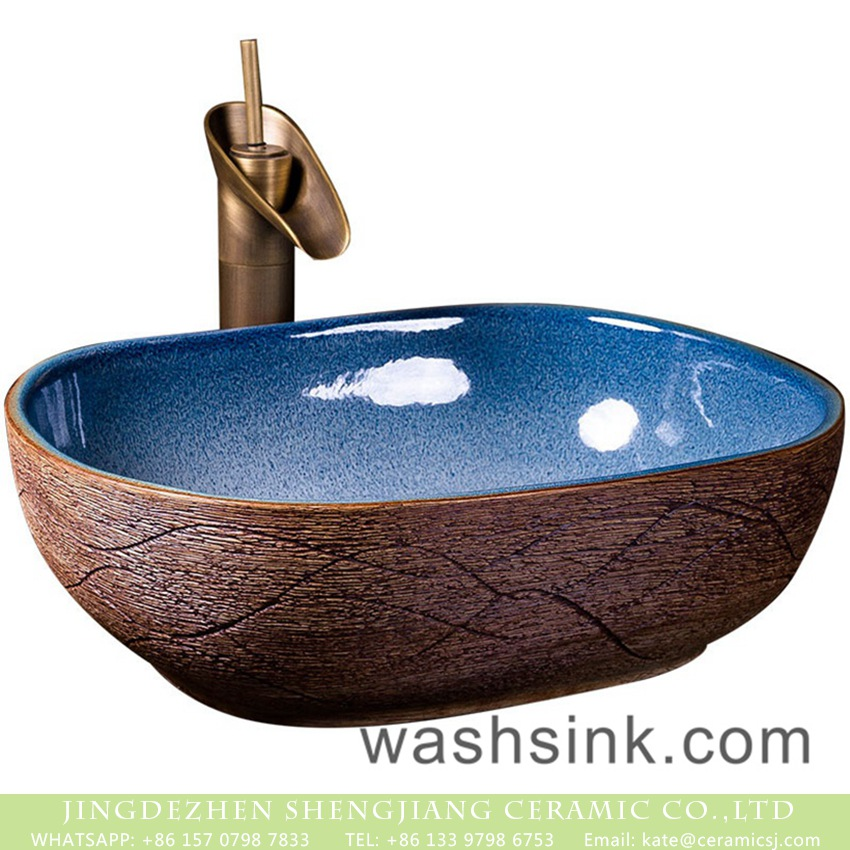XXDD-36-3 Jingdezhen Chinese antique retro style ceramic countertop sink with high gloss light blue wall and carved big wave stripes on imitating wood surface XXDD-36-3 - shengjiang  ceramic  factory   porcelain art hand basin wash sink