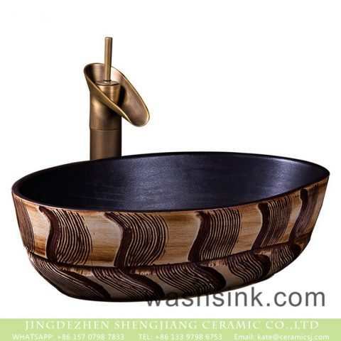Made in China thin edge oval Chinese style ceramic countertop art basin domestic bathroom wash bowl with black wall and wood color hand carved design pattern XXDD-44-1